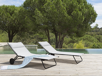 LAFUMA Mobilier sun loungers set up next to a pool