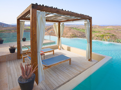 Relaxing area set up around a pool