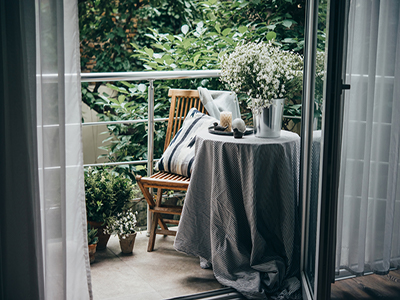 Setting up a small balcony with soft, neutral colours