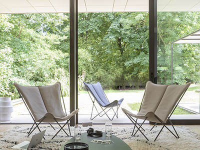 LAFUMA Mobilier lounge chairs in Latte colour set up for a cosy ambiance