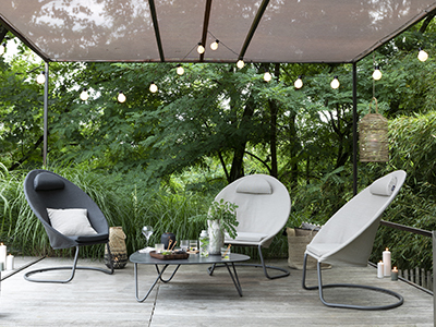LAFUMA Mobilier lounge chairs in Onyx and Latte colourways shown with greenery