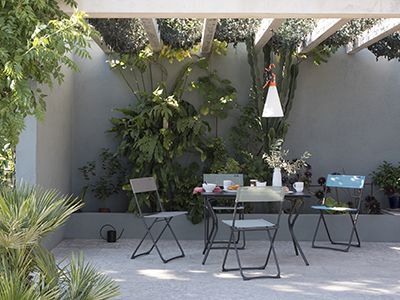 LAFUMA Mobilier table and chair set, arranged on a lush terrace