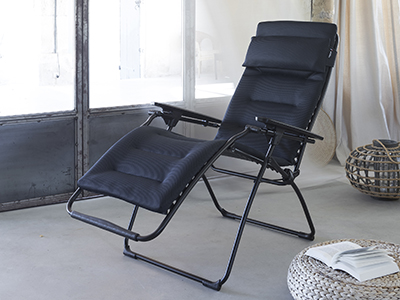 Relax chair from LAFUMA Mobilier shown in a light-filled conservatory