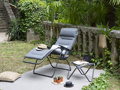 Futura Be Comfort in silver in a small calming and restful garden