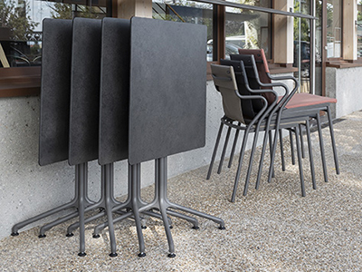 Folded Horizon table and stacked Horizon chairs
